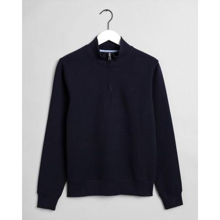 Produzida numa mistura de algodão macio com um visual subtilmente texturizado, a sweatshirt com estrutura e meio fecho de correr.
