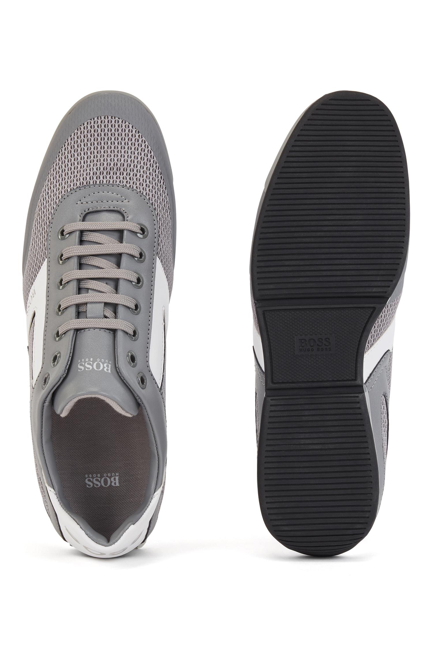 Tênis contemporâneos da BOSS. feitos com malha, elementos reflexivos e detalhes termocolados, esses tênis são impressos com um laser