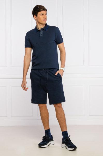 Polo BOSS slim fit com gola tricotada e risca branca em um luxuoso algodão interlock,. Com contraste na carcela onde incorpora o logotipo,